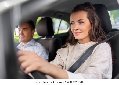 driver courses and people concept - young woman learning to drive car with driving school instructor