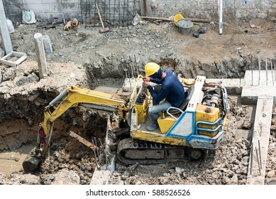 The driver digging for Septic Tank