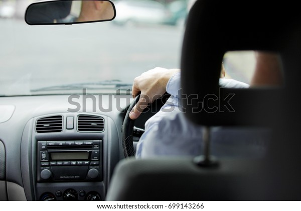 A driver driving a car