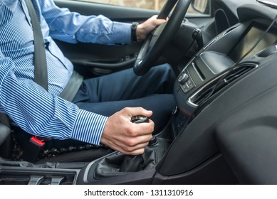 Driver with fastened safety belt in car