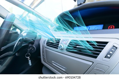 Driver hand tuning air ventilation grille, fresh air is coming out - Shutterstock ID 690104728