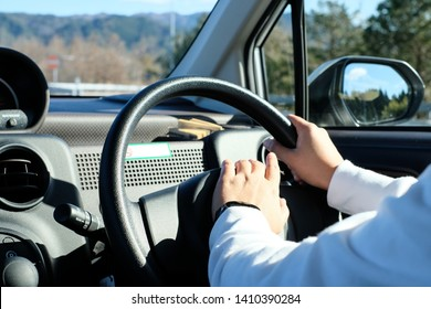 Driver Holding Car Steering Wheel and Honking the Horn