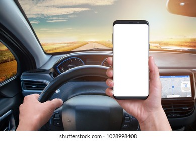 Driver keeps the phone while driving. Isolated screen for mockup. Modern car interior with navigation on board screen.