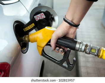 Driver pumping gasoline at the gas station