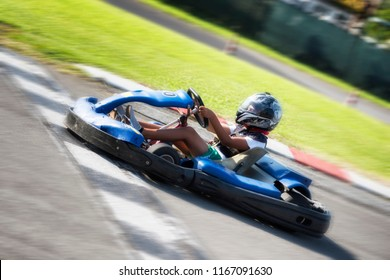 Driver Racing with Go Kart on outdoor circuit
