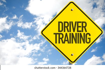 Driver Training sign with sky background