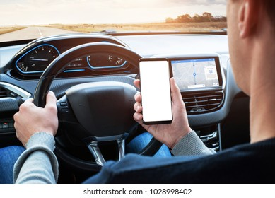 Driver use smart phone while driving. Isoalted screen for app promotion. Modern car interior with car board display with navigation.