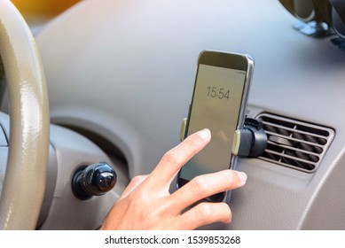 Driver use  smartphone on holder air vent mount