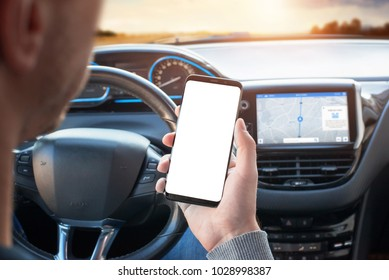 The driver uses the phone while driving. Modern smart phone with round edges. Isolated screen for mockup. Car navigation display in background.