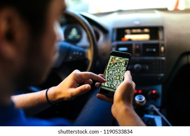 Driver using gps navigation system, online maps and smartphone for guidance