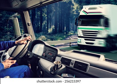 driver view from the cockpit of a truck on the road