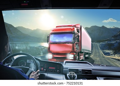 Driver view from the cockpit of a truck on the wintry road, symbolic picture for cargo and transportation companies