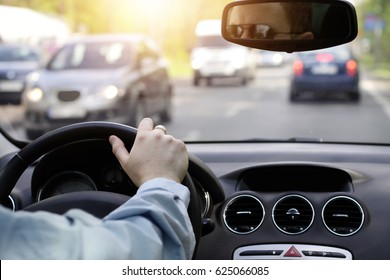 The driver waits in a big traffic jam in the car