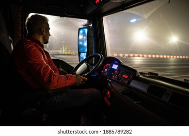 The driver at the wheel of the truck.