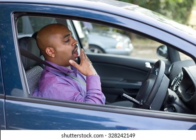 driver yawning in his car
