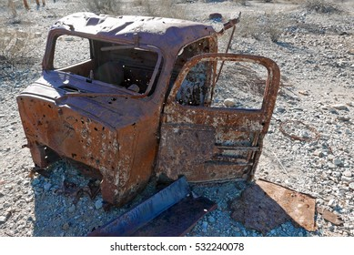 Drivers cabin of an old car rusting and deserted in the American West desert