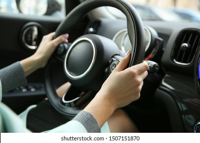 driver's hands on a car steering wheel