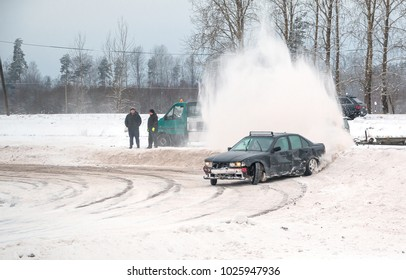 Drivers learn driving on a snowy road. Difficult road conditions.