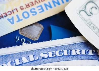Drivers license, social security card and cash making up important items in any American, r person in general. Essential financial and identification documents.