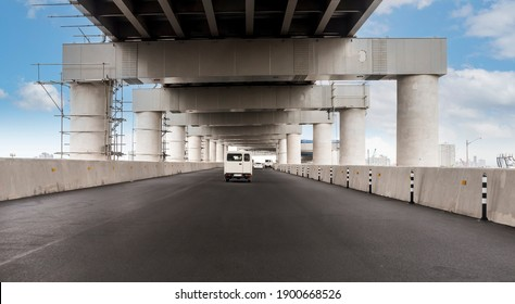 Driver's view of a double-decker portion of Skyway Stage 3, an elevated expressway. Traffic lanes have not been painted yet. In Metro Manila, Philippines.