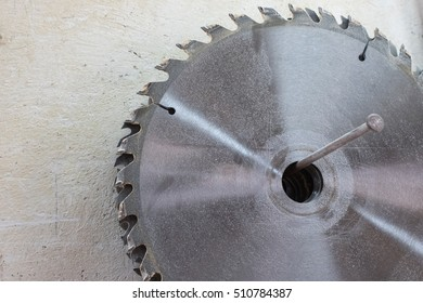 Drives for circular saw hanging on a nail on the wall, close up
