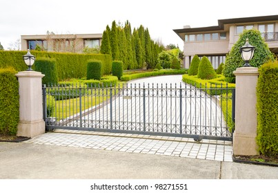 A driveway to the luxury house behind the gates in suburbs of Vancouver, Canada