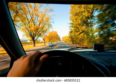 Driving behind the wheel in the truck on California fall season