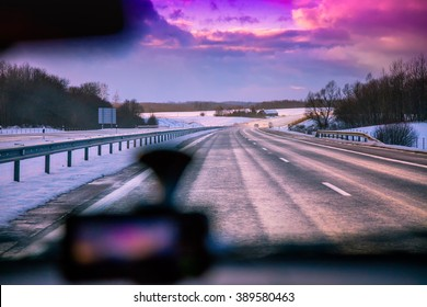 driving a car in autobahn at sunset