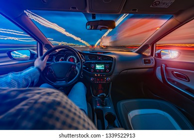 driving a car at dawn in a big city at high speed