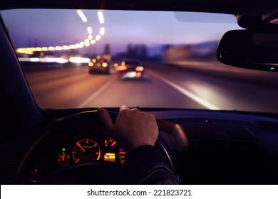 Driving car during sunrise