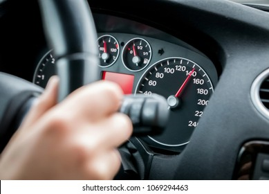 Driving car at motorway at high speed
