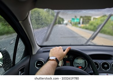 Driving a car on a gray and cloudy rainy day