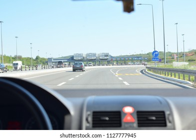 Driving a car on a highway and approaching to a pay toll