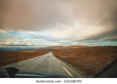 Driving a car on mountain road. Nature of north Norway. Polar circle. The way to Nordkapp