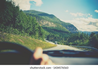 Driving a car on mountain road. Road among mountains, landscape. Beautiful nature of Norway.