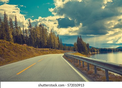 Driving a car on mountain road along fjord. Nature Norway