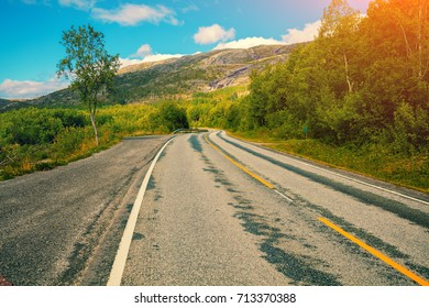 Driving a car on mountain road. Nature Norway
