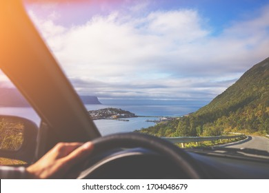 Driving a car on road in Senja island, view from windscreen. Norway, Europe