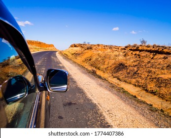 Driving a car on scenic Route Nationale 7 (RN7) through the savannah of Madagascar highlands