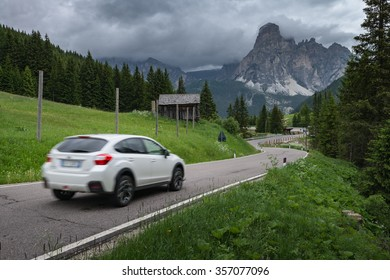 Driving car through mountain pass in Dolomites, Passo Campolongo