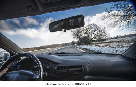 Driving a car in the town with ice and snow