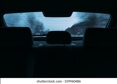 driving a car in the view the rear window. inside the car