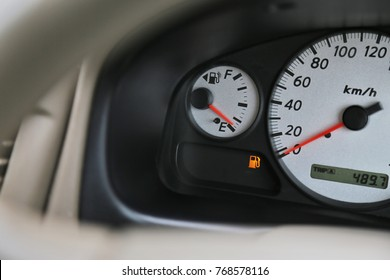 Driving with digital oil gasoline level sign on the dashboard indicates that   oil gasoline is running low.