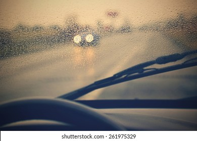 Driving from the driver's perspective in bad weather in the rain.