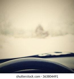 Driving from the driver's perspective in bad weather in the snow. Winter automobile background.