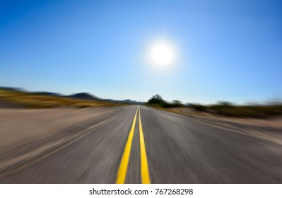 Driving fast down a roadway concept . Abstract travel or racing image.