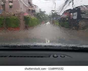 driving in heavy rain especially around vehicles. rain on a car window. The visibility was poor. I could hardly see. It's raining very hard.It's raining cats and dogs. It's going to rain.