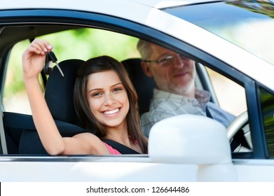 driving instructor teaching student learner driver