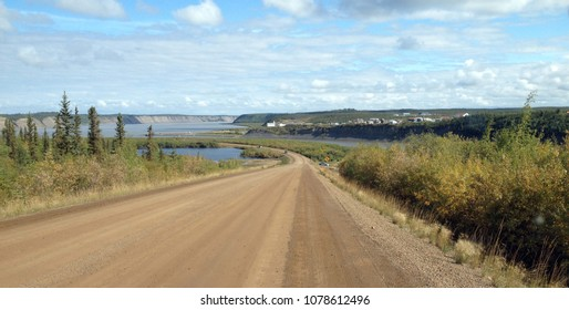 Driving into Tsiigehtchic on the Dempster highway to take the ferry across the Mackenzie River. Northwest Territory, Canada.