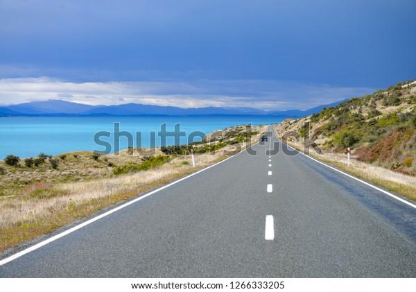 Driving Lake Pukaki, near Glentanner and Twizel, New Zealand.